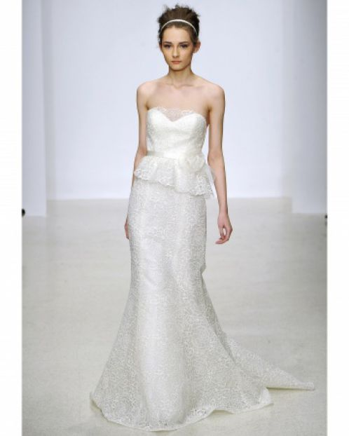 A wedding dress with a lace peplum by Christos, Spring 2013